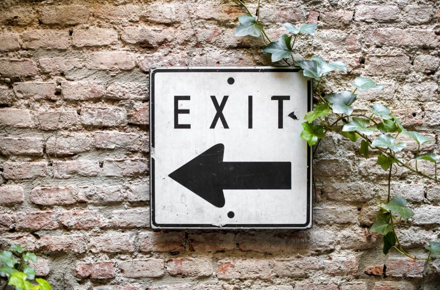 Exit direction sign pointing to the left